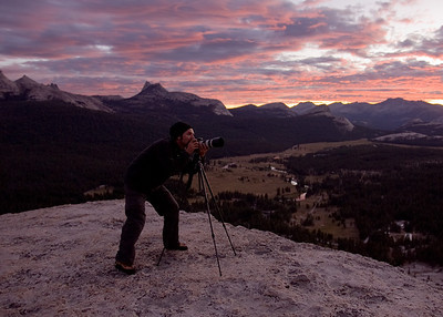 James McGrew photographing on Lembert Dome, Yosemite, CA.  Photo by Ron Kauk.