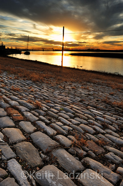 Sunset over the Mississippi River seen from an old cobblestone road in Memphis Tennessee