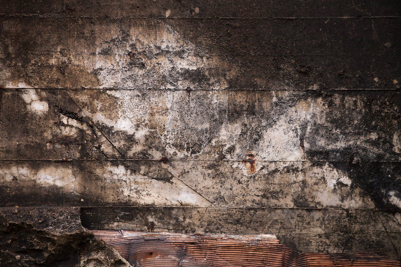 Cement wall with textured, dirty surface