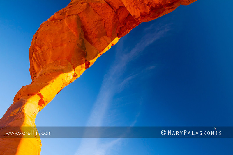 Under Delicate Arch with the sun low.<br /> <br /> Arches National Park, Utah<br /> Photography by Mary Palaskonis