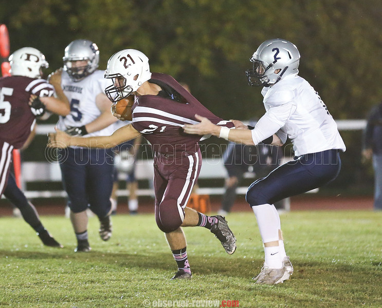 Ryan Prior is held as he tries to pick up yardage in the game against Mynderse, Friday, Oct. 6.
