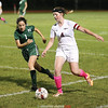 Hailey Perraut dribbles past a Newfield defender, Thursday, Oct. 5.