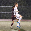 Alex Thiesmeyer works to control the ball in the pouring rain, Wednesday, Oct. 11.