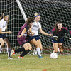 Katlyn Kernan, Kiersten Stiles and Cierra Barber work to protect the goal against Odessa's Lillian Betts (front), Wednesday, Sept. 27.