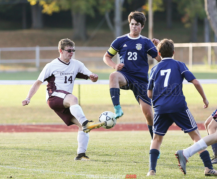 Brandon Edmister works to settle the ball as a Marcus Whitman defender tries to deflect it, Thursday, Sept. 28.