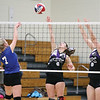 Brianna Pratt and Robin Jenkins jump to block a Houghton return during the sectional game at Prattsburgh.