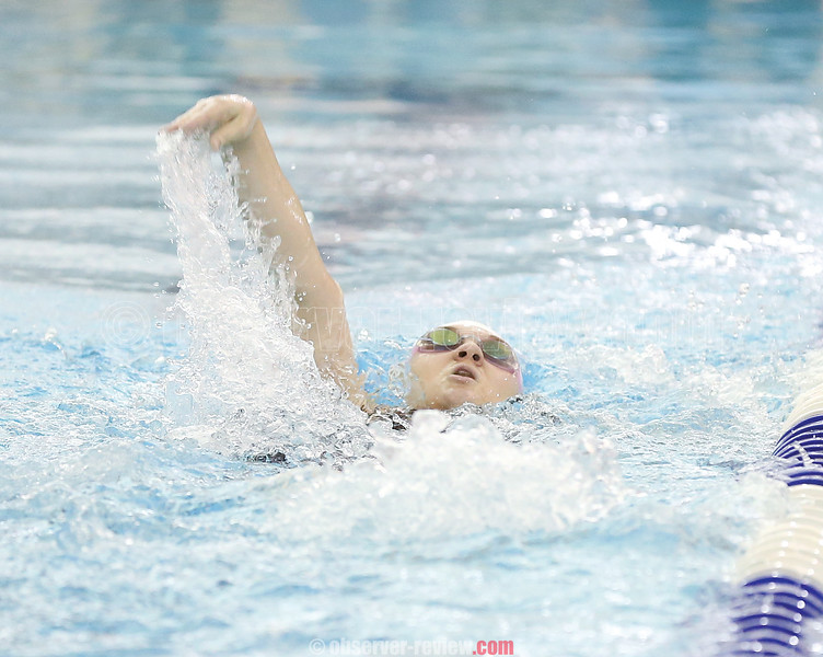 Liza Carnes swims the backstroke for Watkins in the medley race during the sectional prelims.