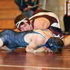 Jeremiah Lynch works to improve his position on the way to a pin against Moravia, Wednesday, Dec. 6.