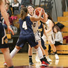 Alexandria Wood works against a Marcus Whitman defender, Thursday, Dec. 7.