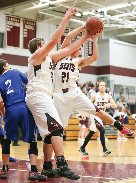 Robbie Clark and Ryan Prior reach up for a rebound during the game, Wednesday, Dec. 6.