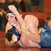 Dylan Houseknecht pins his Moravia opponent last week and waits for the match to be called.