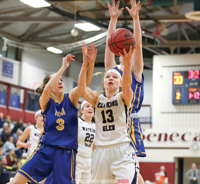 Clara Chedzoy grabs for a rebound in the game against Tioga, Friday, Dec. 8.