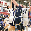 Joe Chedzoy and Dayne Hughey jump for a rebound, last Friday evening.