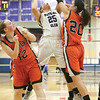 Mariah Gonzalez jumps for a rebound against Walton, Friday, Feb. 24.