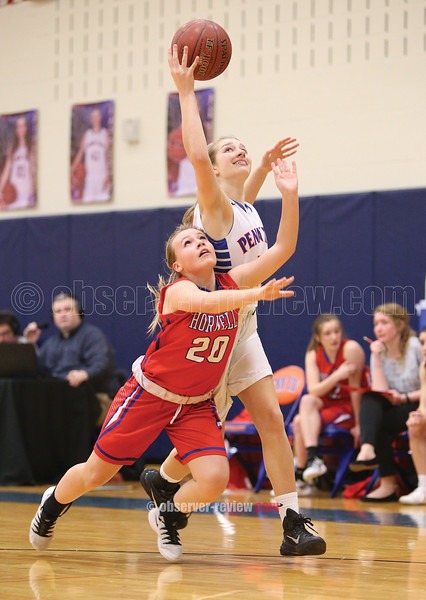 Jenna Curbeau reaches to control the ball Wednesday, Feb. 22.