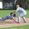 Alex Grady dives safely back to first base in the game last week.