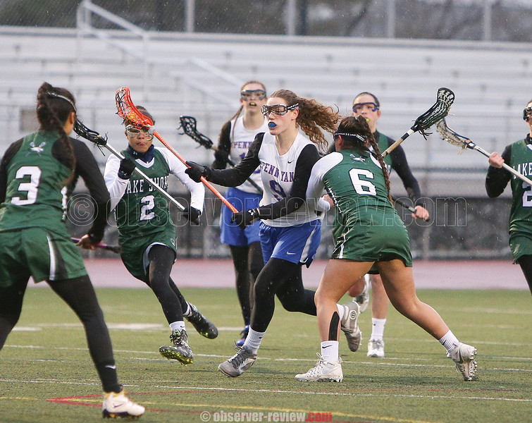 Brooke Dinehart splits the defense, Friday, March 31 at Penn Yan.