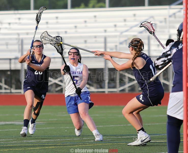 Hannah Keech receives contact as she nears the goal against Mynderse.