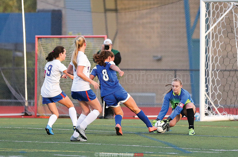 Captain Melanie Gleason blocks a shot on goal last week.