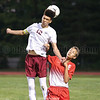 Curtis Harris jumps for a header in the game with Groton, Wednesday, Sept. 6.