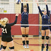 Hanley Elliott and Megan Hazlitt jump at the net to try and block a Spencer-Van Etten spike, Thursday, Sept. 14.