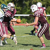 Dundee's Kyle Cratsley hands the ball to Ryan Prior in the football game against C.G. Finney, Saturday, Sept. 23.
