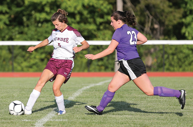 Adele Fishbaugh tries to keep the ball away from Hammondsport's Faith Bray last week.