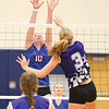 Penn Yan's Emily Wunder jumps to block a spike by Hammondsport's Julia Bennett, Thursday, Aug. 31.