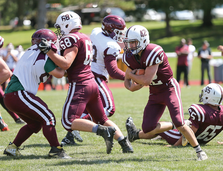 Cameron Denmark blocks for Billy Bowers in the Saturday game against Lyons/Sodus.
