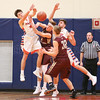 Derrick Rivello (far left) and Dylan Stape (far right) battle to control a rebound, Wednesday, Jan. 3.