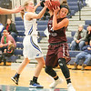 Nakiaha Robinson grabs a rebound in the Friday evening game.