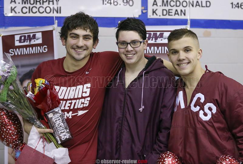 Seniors Billy Tague, Cameron Adams and Alec Betts have a photo taken during senior night Friday, Jan. 26.