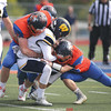 Andrew Garren (67) and Damien Snyder (24) team up for a tackle early in the game, Saturday.