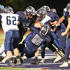 Gage Arcangeli (52), Wyatt Brower (66) and Wrett Brower (55) make a tackle against Moravia, Saturday, Oct. 13.