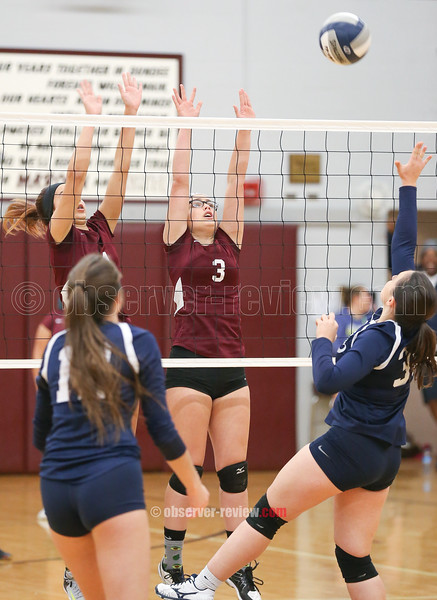 Mackenzie Strait and Elizabeth Medina go up at the net to block for Dundee, Thursday, Oct. 18.