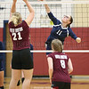 Odessa's Jolynn Minnier tries to block a spike by Watkins Glen's Claudia Parker, Wednesday, Sept. 26.