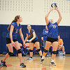 Kayla Anderson (5) and Lauren Chinski (7) look on as Serina Sheradin (13) sets the ball in this file photo from Oct. 19. FILE PHOTO