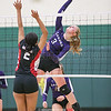 Julia Bennett goes high to spike the ball in the sectional game.