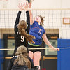 MVP Caitlin Wunder spikes the ball against LeRoy.