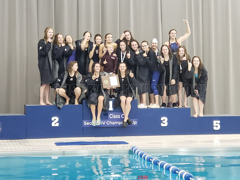 The winning Watkins Glen girls swimming team has a photo taken on the new podium at the school, Saturday, Nov. 3. PHOTO FROM:Watkins Glen Central School District News & Notes