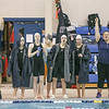 Watkins swimmers and coaches cheer during a race.