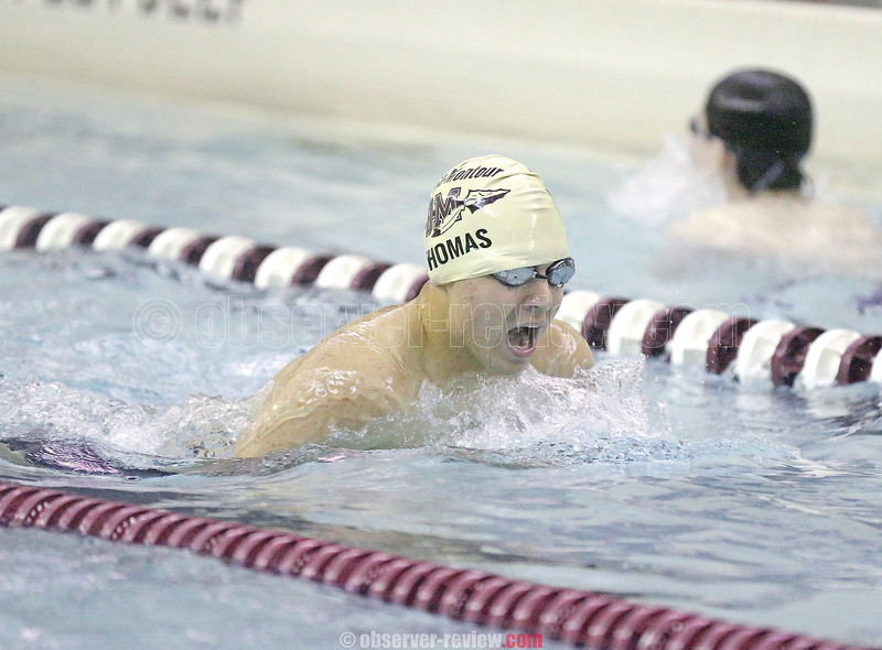 Caleb Thomas swims to a second place finish in the 100 breaststroke.