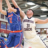 Collin Baker reaches for a rebound in the game last week.