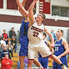 Brandon Edmister reaches for a rebound, Wednesday, Dec. 5 against Romulus.