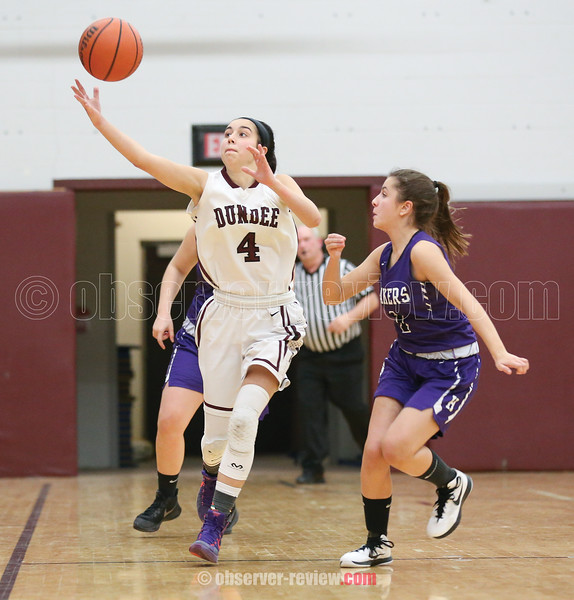 Dundee's Mackenzie Strait reaches for the ball as Hammondsport's Paula Garcia looks on.