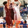 Peyton Schuck moves to the basket under pressure from Newark defenders last week.