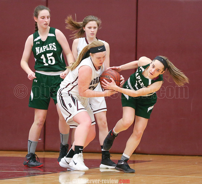 Megan Sutherland forces a jump ball in the game against Naples, Feb. 8.