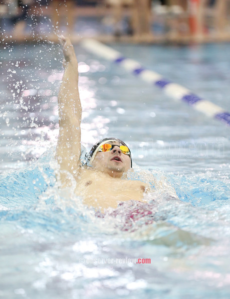 Odessa's Billy Tague swims the backstroke portion of the 200 IM in the sectional prelims, Wednesday, Feb. 14.