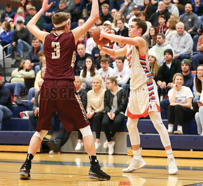 Ben Emerson looks to pass the ball to a teammate in the game against Wayland-Cohocton.