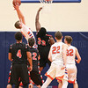 Cade Curbeau pulls down a rebound for Penn Yan giving them possession late in the fourth quarter.